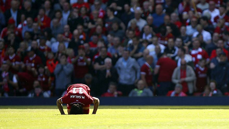 Star who embraces Muslim faith carries Egypt's World Cup hopes on ailing shoulder
