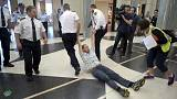 Environmental protesters forcibly removed from Australian parliament