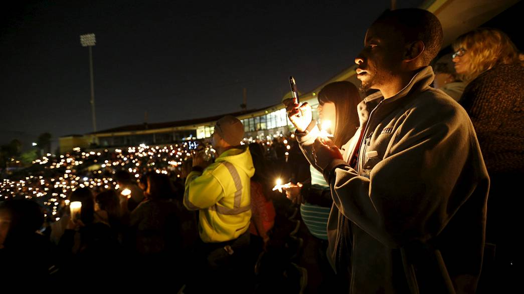 Vigils held for California shooting victims as suspect is described as 'a nice person'