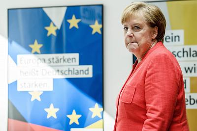 German Chancellor Angela Merkel arrives at a press conference in Berlin on Monday.