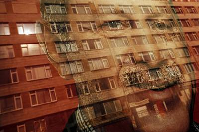 A reflection of a poster showing Turkish President Recep Tayyip Erdogan in Istanbul.