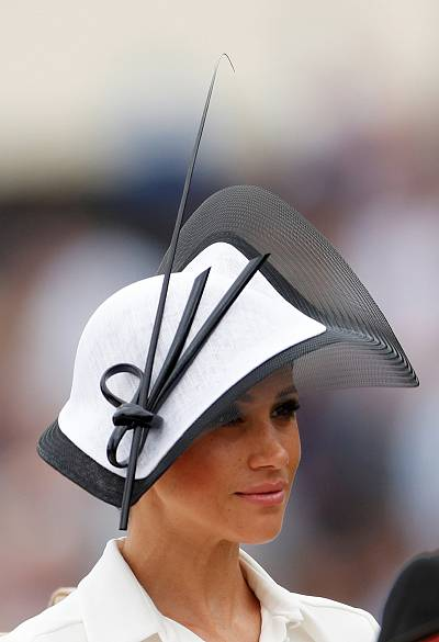 The duchess wore crisp white with bold black accents, including an intricate design on her hat.