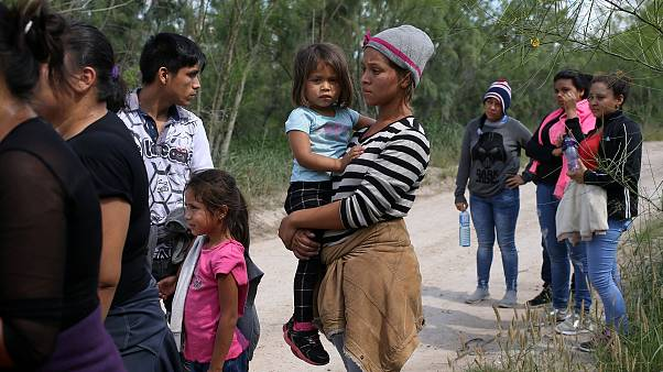 Image: Family units who illegally crossed the Mexico-U.S. border turn thems