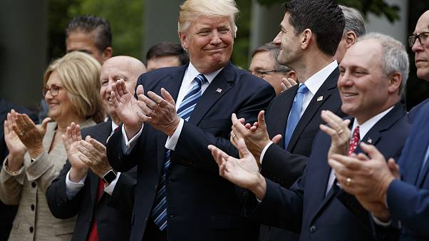 Image: Trump smiles at Rep. Paul Ryan