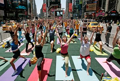 Yoga enthusiasts from across the country participate in the annual Summer Solstice in Times Square Yoga-thon.