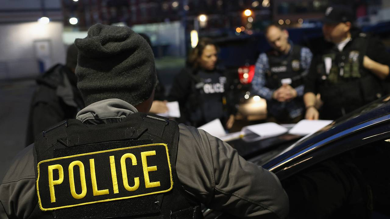 Image: U.S. Immigration and Customs Enforcement (ICE) officers prepare for