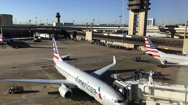 Image: An American Airlines plane sits at the gate at Dallas Fort Worth Int