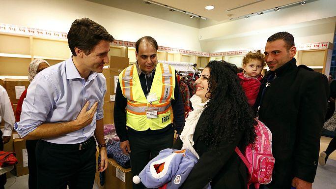 رئيس الوزراء الكندي يستقبل اللاجئين السوريين