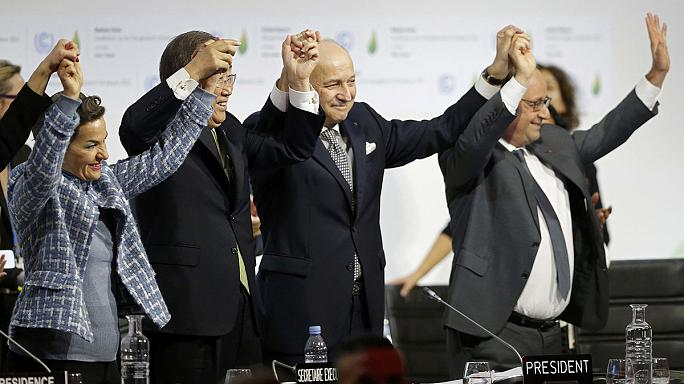 COP21 Delegates vote to adopt historic deal