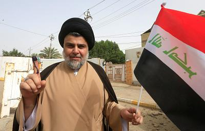Cleric Muqtada al-Sadr shows his ink-stained finger after casting his vote on May 12.
