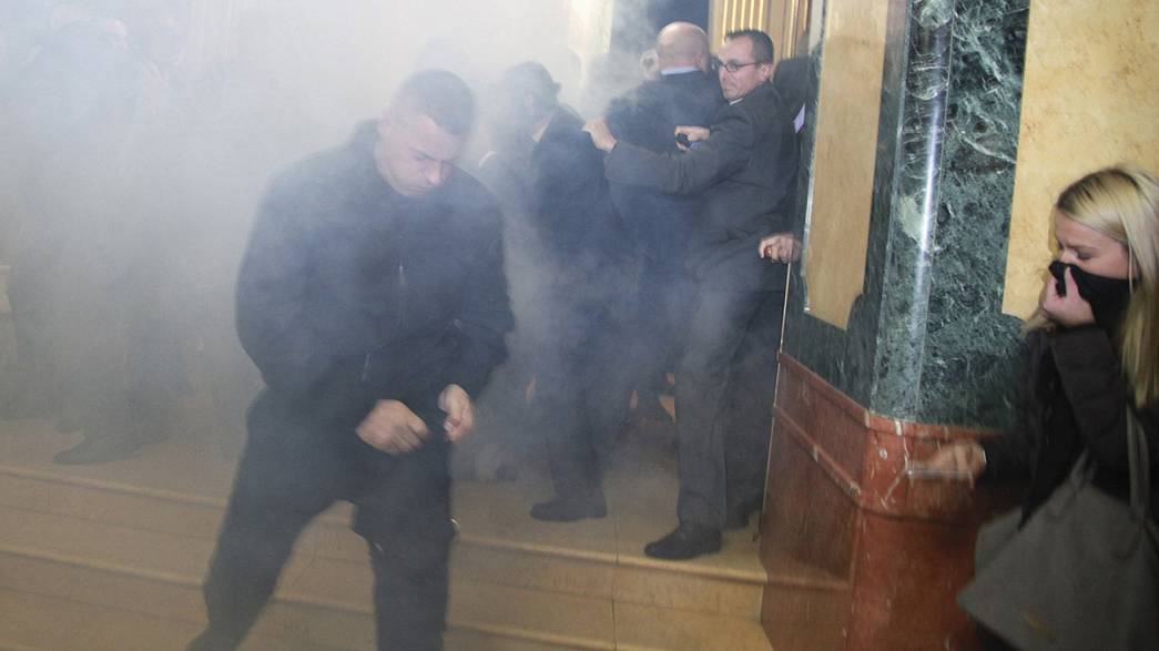 Watch: dramatic scenes as MP sets off smoke bomb in Kosovo parliament