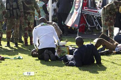 Injured people are attended to as they lay on the ground following an explosion at President Emmerson Mnangagwa\'s rally in Bulawayo, Zimbabwe, on Saturday.