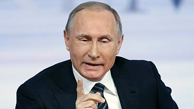 Turkey's downing of Russian plane 'a hostile act' says Putin