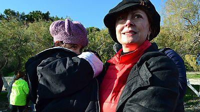 """Have courage, you'll make it:"" Susan Sarandon comforts Iranian refugee on Lesbos"
