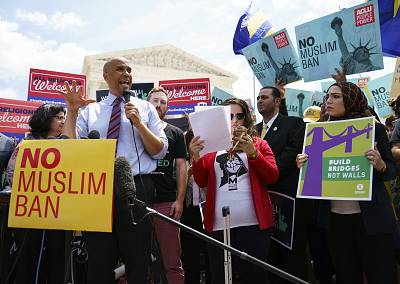 """Rep. Cory Booker, N.J., speaks during the """"We Will Not Be Banned"""" protest sponsored by Muslim Advocates in front of the Supreme Court on Capitol Hill in in Washington on June 26, 2018."""