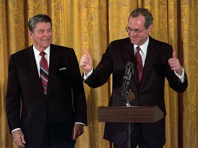 Supreme Court Justice Anthony Kennedy gives the thumbs-up after taking the constitutional oath at the White House on Feb. 18, 1988 as President Ronald Reagan looks on.