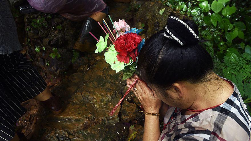 Image: A woman prays