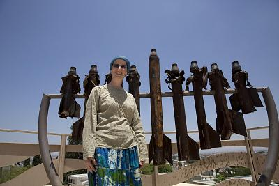 Mechi Fendel, wife of Rabbi David Fendel of Sderot Yeshiva, in front of a menorah created with rockets fired from Gaza.