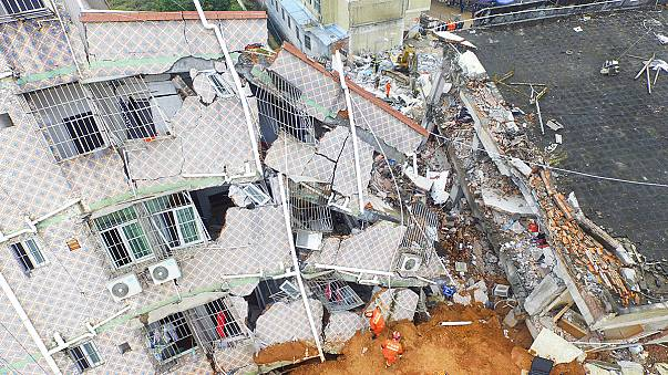 Scores buried as mudslide engulfs buildings in China