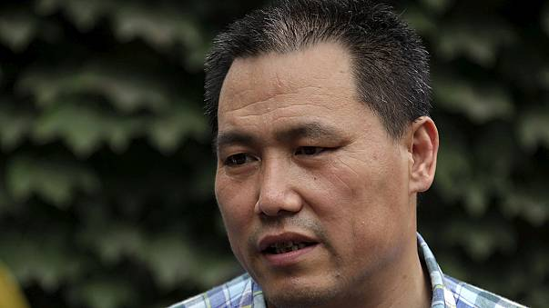 Pu Zhiqiang: Chinese human rights lawyer gets suspended jail term
