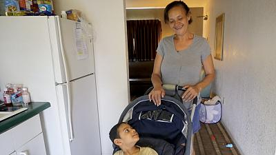 Maria Baez and Christian Dariel, a Puerto Rican family who was living in Florida under FEMA\'s Transitional Shelter Assistance program.