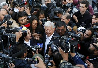 Andres Manuel Lopez Obrador is surrounded by members of the media after casting his ballot in Mexico City on Sunday.