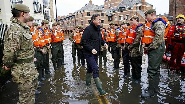 Cameron promises more funds for flood defence