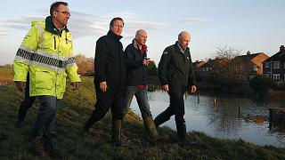 UK: Cameron to review gov't spending on flood defenses