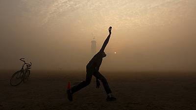 Kolkata cricketer silhouetted in heavy morning fog