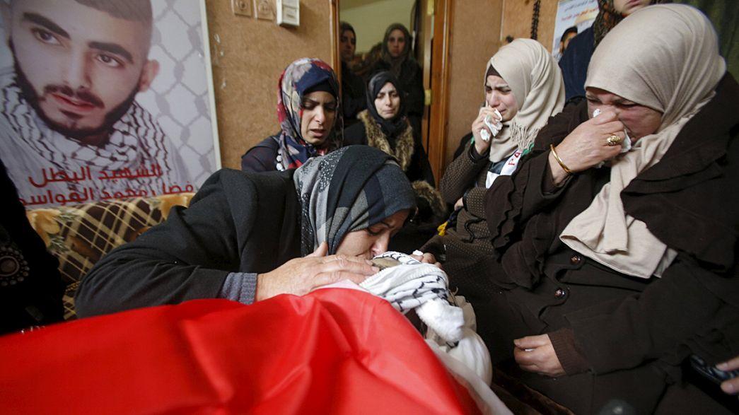 West Bank crowds mourn 14 killed in recent violence