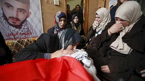 West Bank crowds mourn 14 killed in recent violence