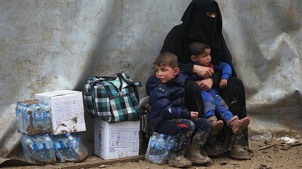 Image: Civilians from Mosul wait after arriving in a camp