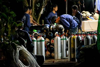 Diving cylinders are prepared at a makeshift camp at the entrance of Tham Luang Nang Non caves for the divers to continue the rescue operation for the 12 trapped children and their coach on July 6, 2018, in Chiang Rai, Thailand.