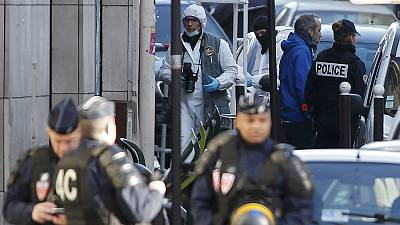 'Paper with ISIL flag' found on knifeman shot dead at Paris police station