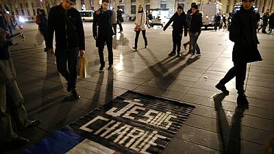 Parisians gather to remember victims of Charlie Hebdo attacks