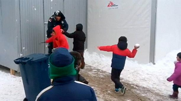 Young migrants attack Serbian border police... with snowballs!