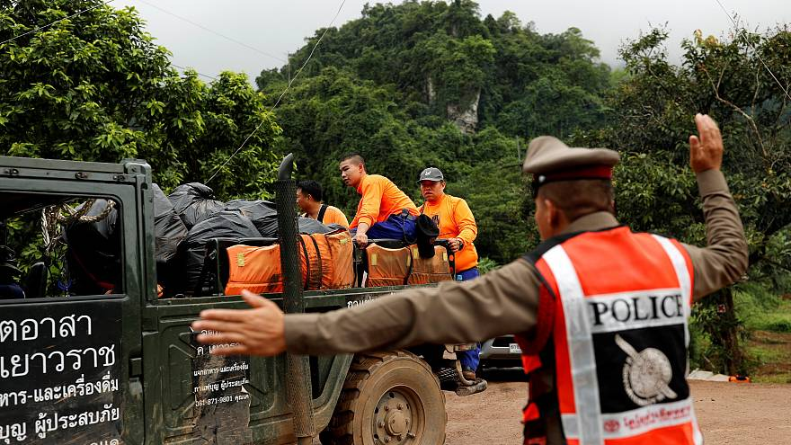 Image: Rescue workers are seen near the Tham Luang cave complex, where 12 s
