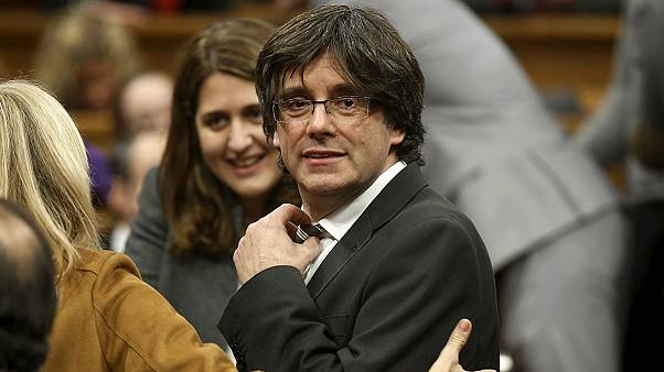 Pro-secession Carles Puigdemont voted in as leader of Catalonia