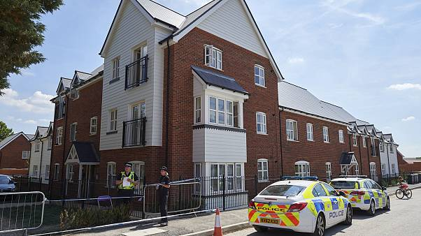 Image: Police officers stand guard at a residential house in Amesbury