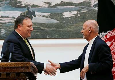 Afghan President Ashraf Ghani and U.S. Secretary of State Mike Pompeo shake hands during a news conference in Kabul on July 9.