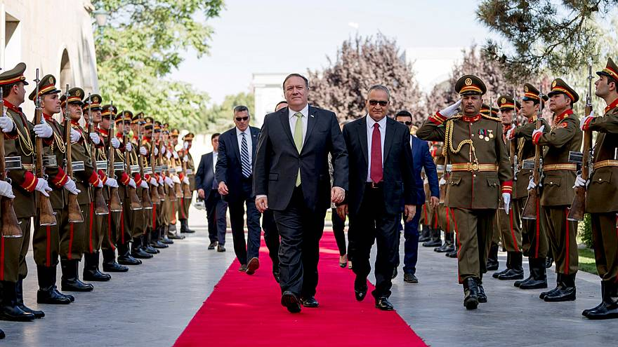 Image: U.S. Secretary of State Mike Pompeo is greeted by Chief of Staff Abd