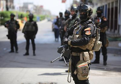 Members of Iraq\'s anti-terrorism force deployed outside polling stations in central Baghdad on Tuesday, one day ahead of Iraq\'s first general election since U.S. troops withdrew.