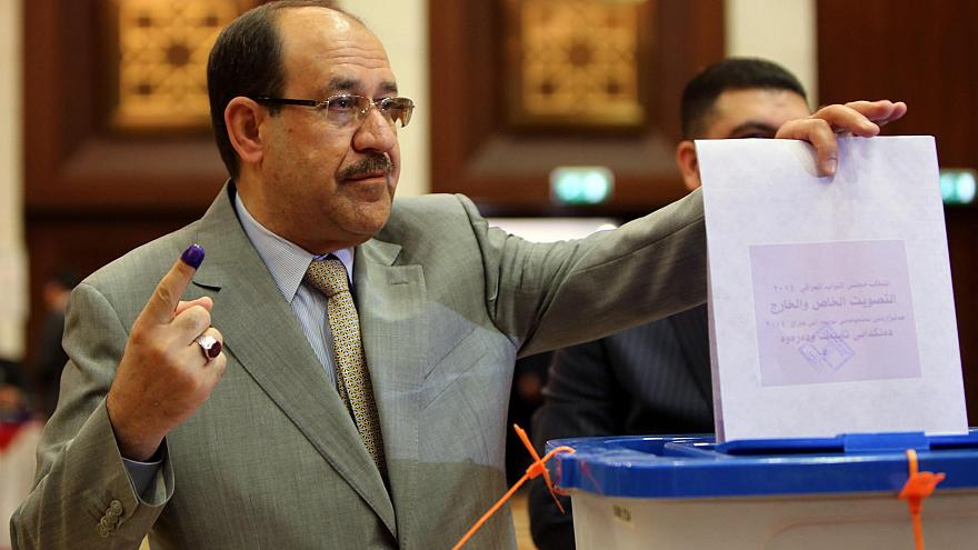 Image: Iraqi Prime Minister Nouri al-Maliki shows his ink-stained finger as