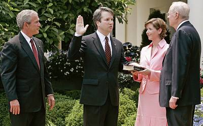 Brett Kavanaugh is sworn in by Supreme Court Justice Anthony Kennedy to be a judge to the U.S. Circuit Court of Appeals for the District of Columbia as his wife Ashley and President George W. Bush look on in the Rose Garden of the White House on June 1, 2006.