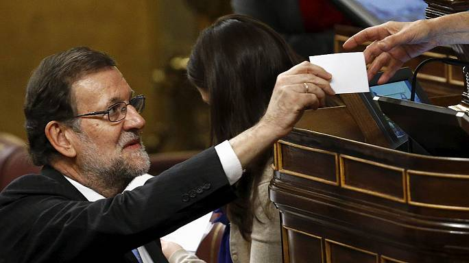 Rajoy calls for broad coalition as split parliament reconvenes