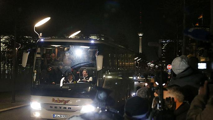 German official buses dozens of migrants to Merkel's office