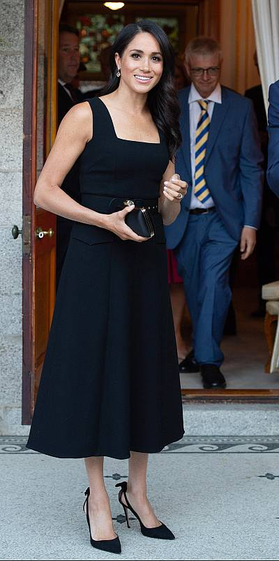 The duchess changed into a sleeveless black dress for a party at the British ambassador\'s residence.