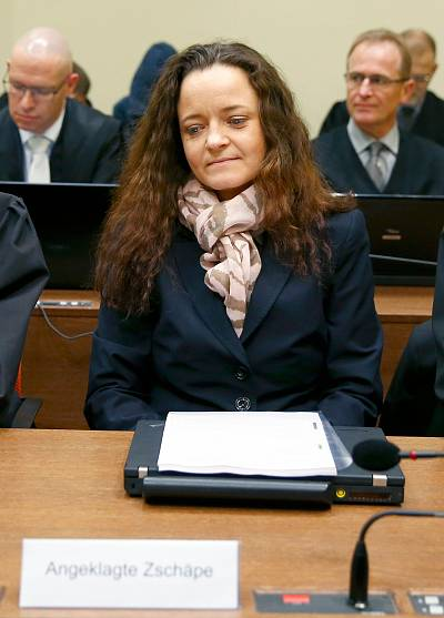 Defendant Beate Zschaepe arrives for the continuation of her trial at a courtroom in Munich, southern Germany on Dec. 9. The lone surviving suspect in a neo-Nazi murder case that shocked Germany plans to break her two-and-a-half-year silence and address all the allegations in court, her lawyer said in a German media interview on Monday.