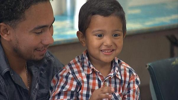 'Hello, Daddy': Migrants reunite with separated children
