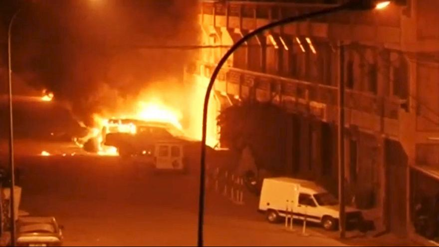 Security forces in Burkina Faso storm hotel to free hostages taken by suspected Islamic militants - reports of 20 dead
